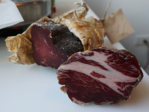 Coppa (pork collar) in foreground and Bresaola (beef eye of round) in background