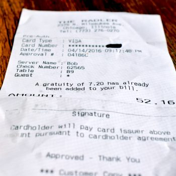 A receipt from The Radler clearly indicates the included tip. In fact, there is no line for an additional tip - only the customer's signature.
