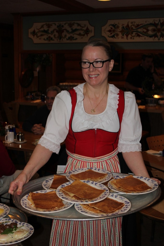 Server in Swedish attire, serving up pancakes at Al Johnson's/Photo: David Hammond