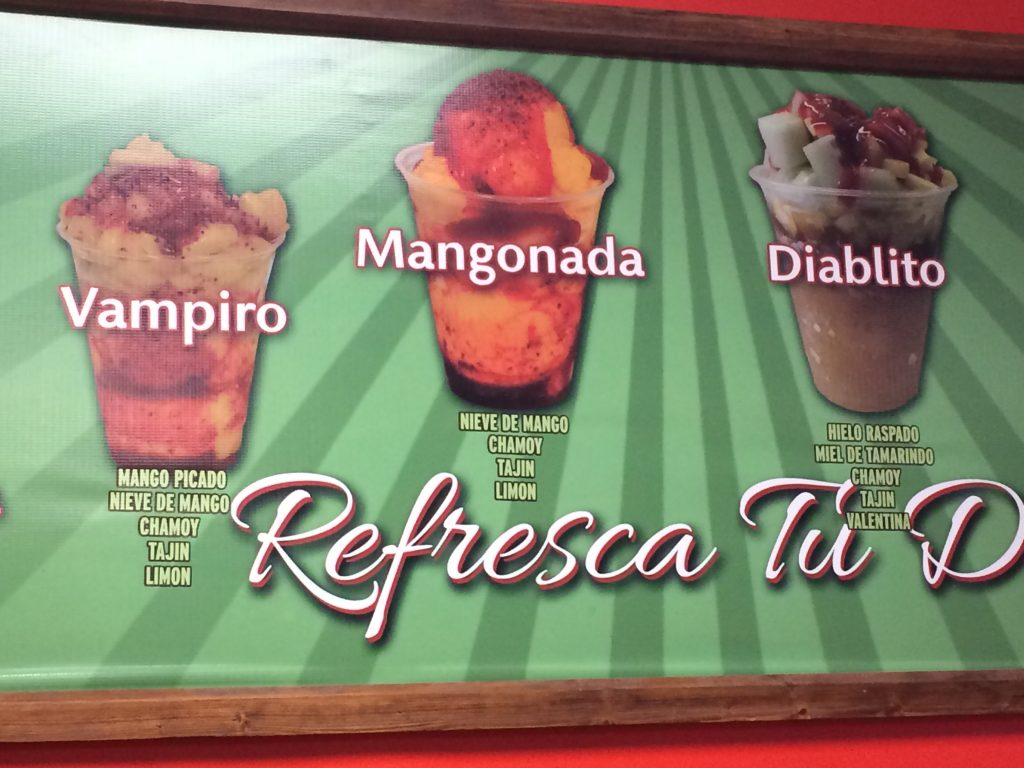 Menu board showing Mangonada, Vampiro and Diablito images with ingredients.