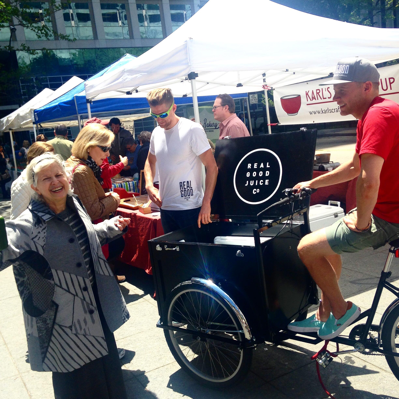 John Schiff, on bike, vending Real Good Juice/Photo: Rosemary Lane
