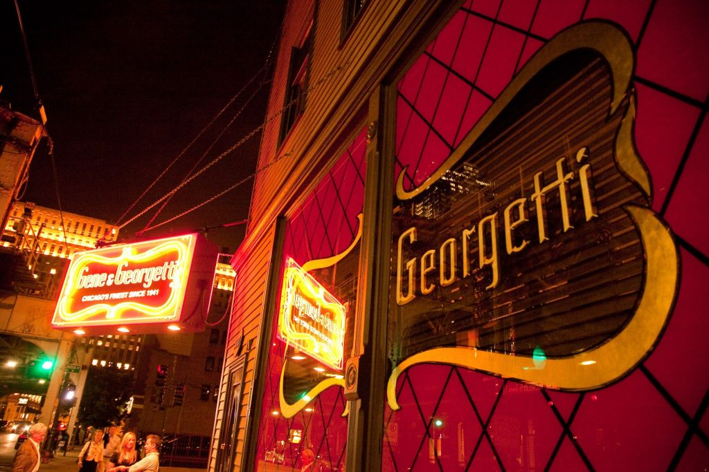 Gene & Georgetti entrance sign on corner