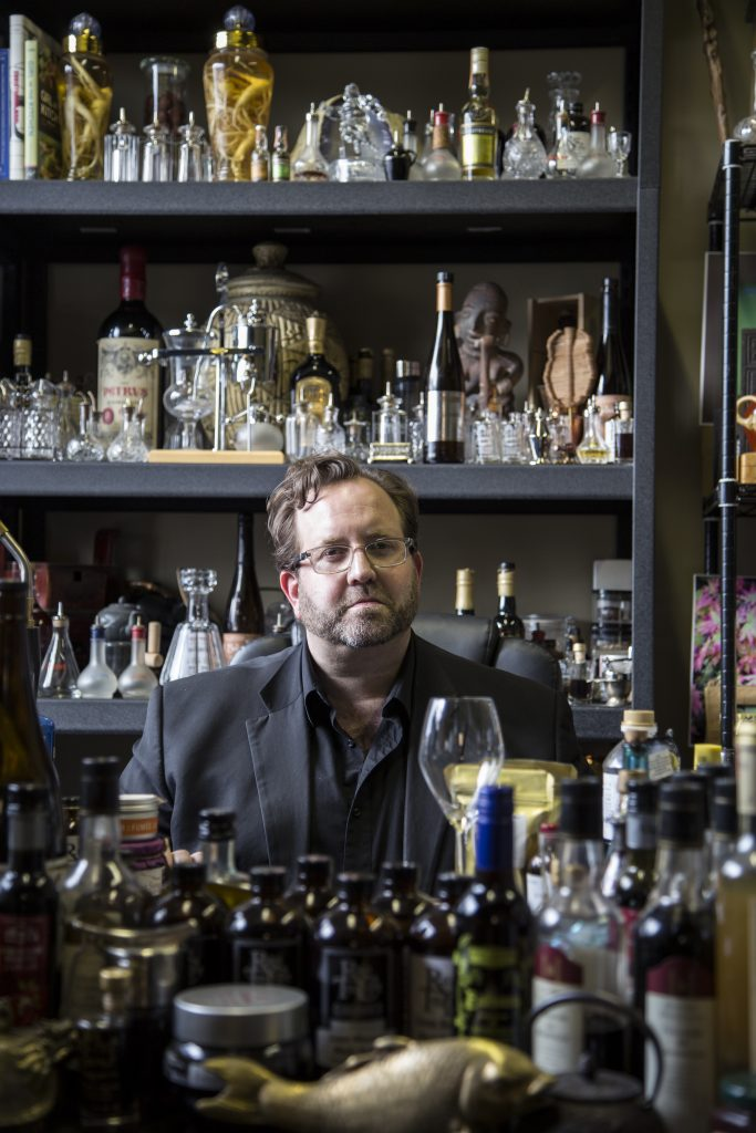 Rodrick Markus sits between shelves of Rare Tea Cellar ingredients
