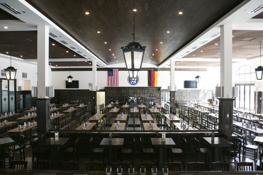 Interior beer hall with lanterns above.